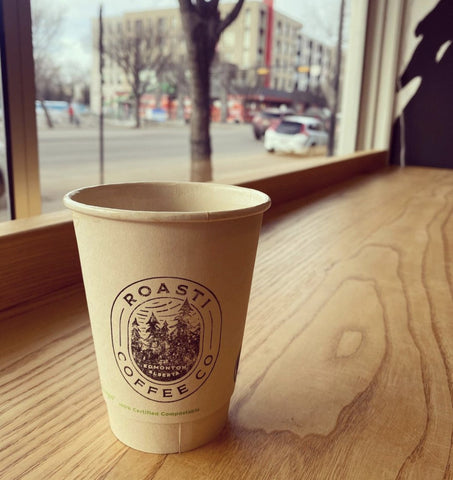 Roasti Coffee Co. paper cup sitting on cafe counter