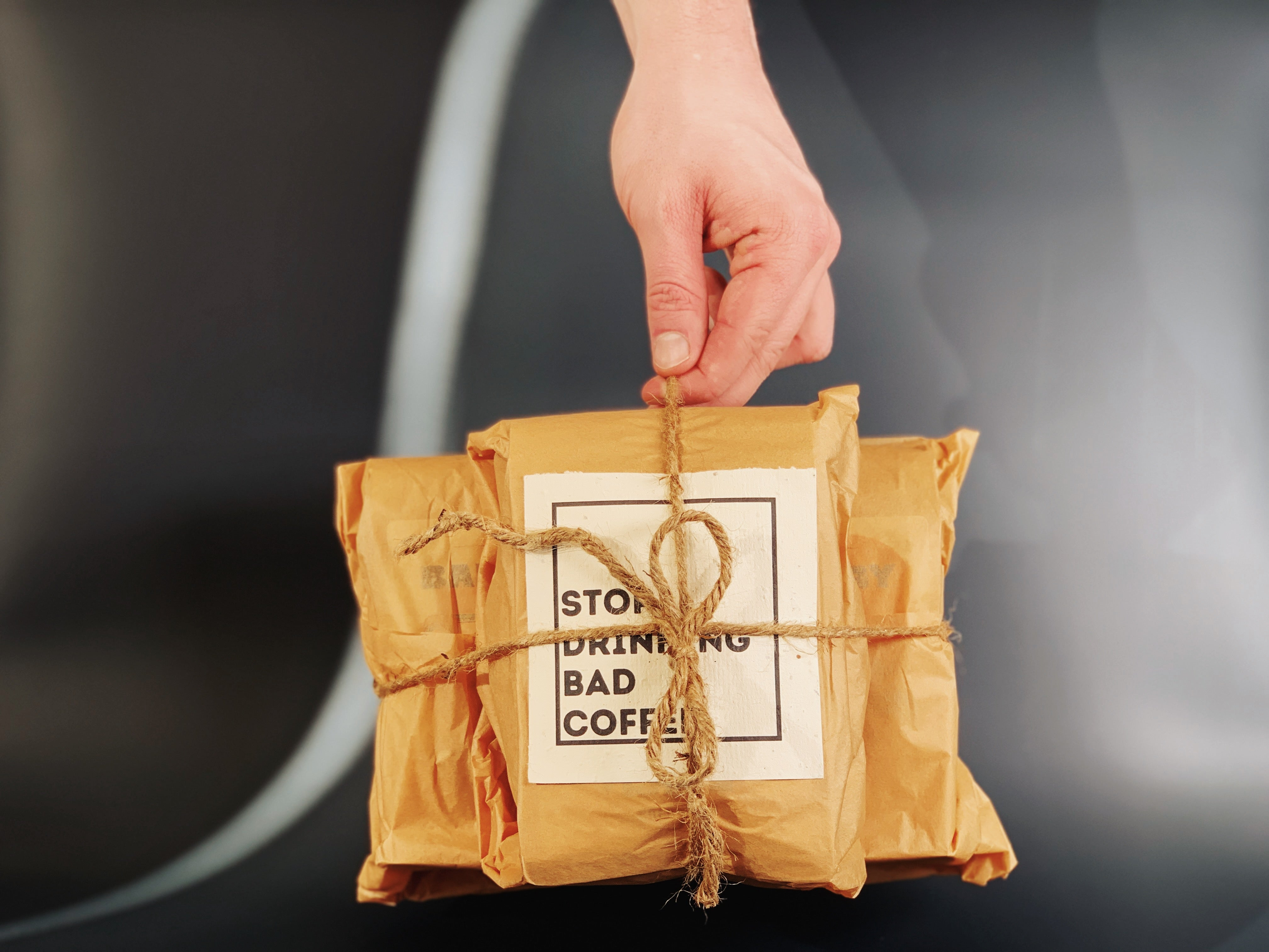 Gold Door Coffee zero waste canadian coffee subscription menage a trois 3 pack gift box held by hand