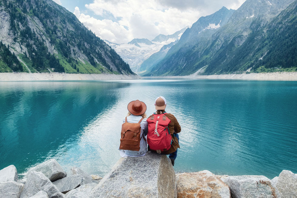 couple look at mountain by a lake