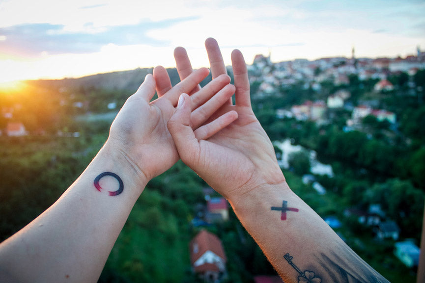 couple with tattoo on hands