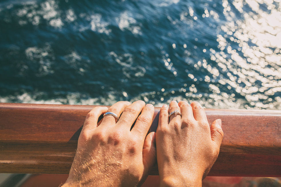 couples hands wedding rings