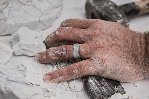 hand with wedding ring doing construction