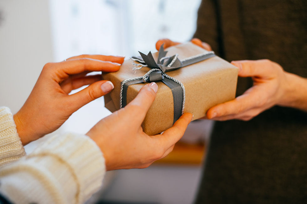 hands giving gift box