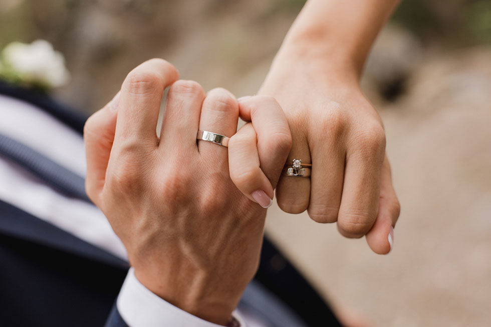 man and woman with wedding rings