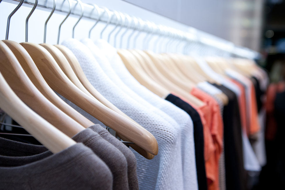 neutral colored clothes on hangers