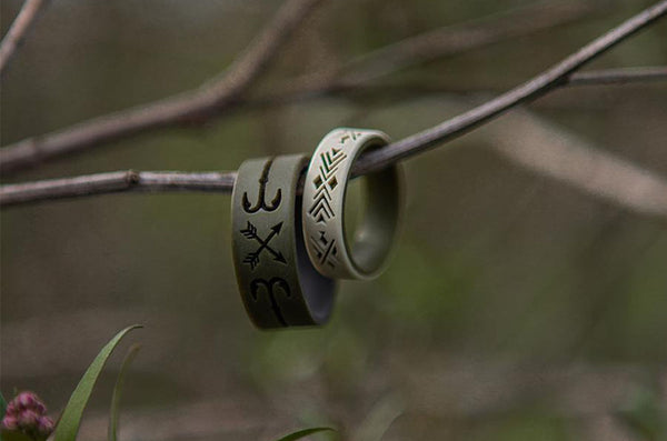 pair of wedding rings on branch