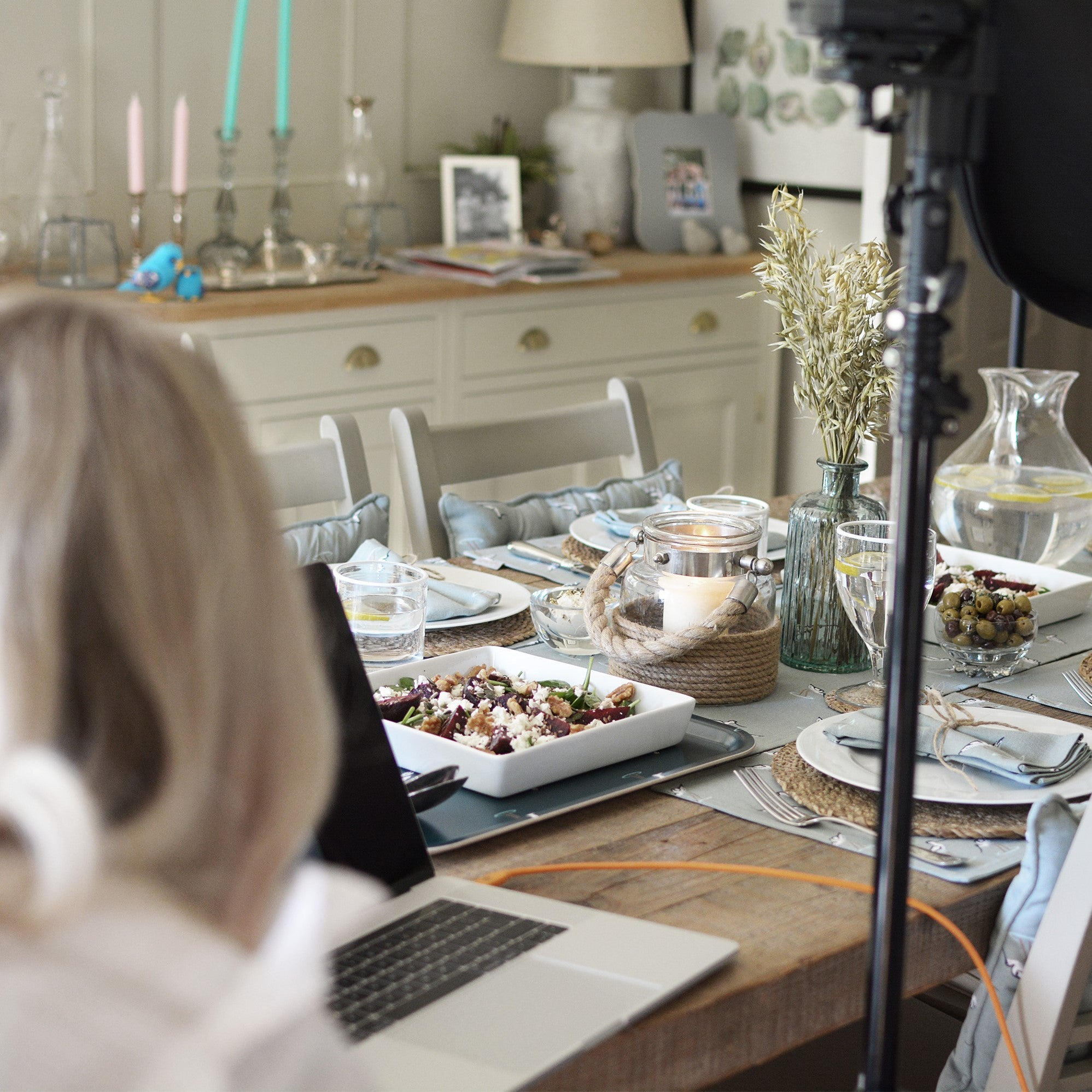 We step behind the scenes at Sophie Allports new coastal collection which features Avocets on a sea-blue background. We see our photographer capturing a coastal table setting.
