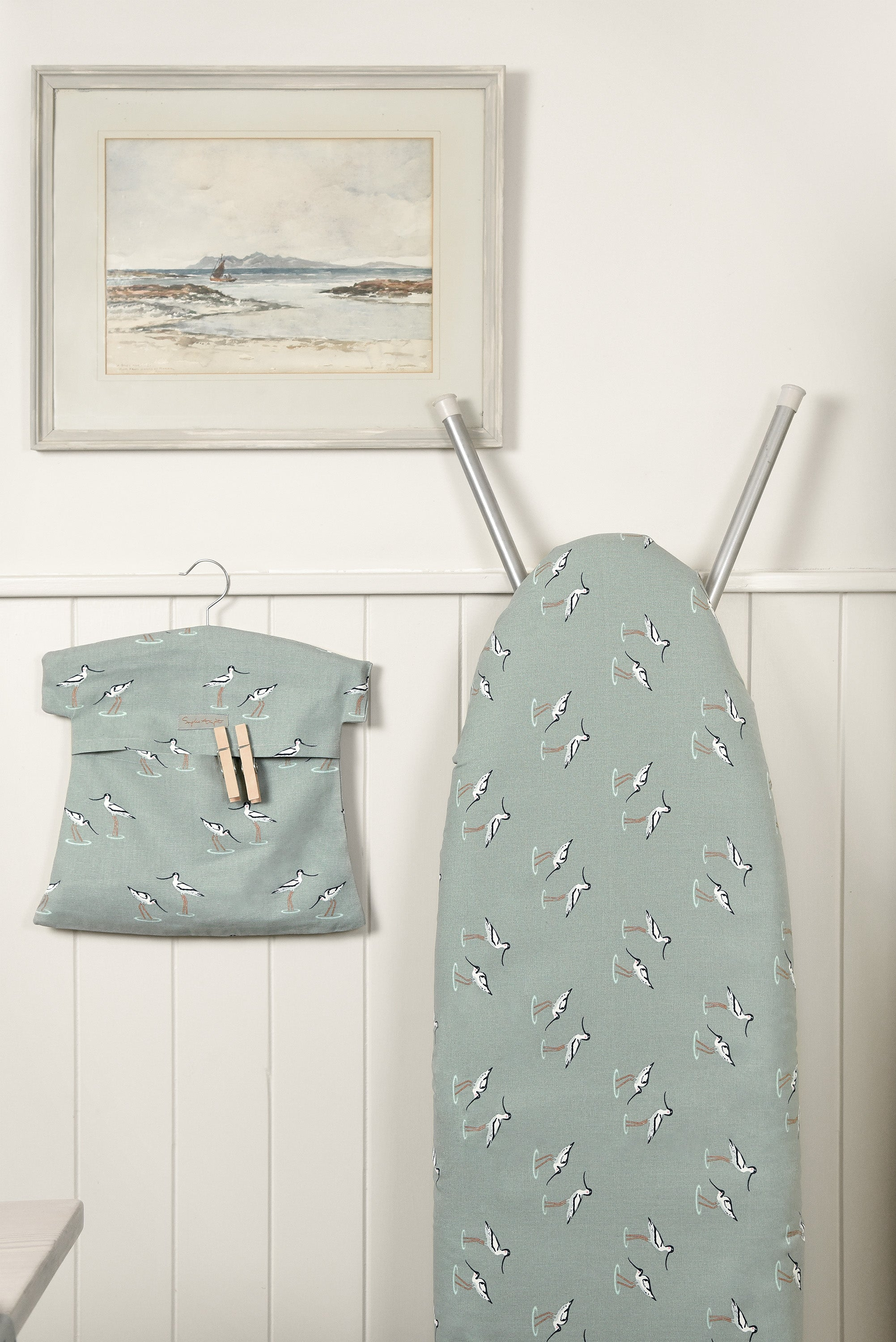 Sophie Allport utility room inspiration in sea blue green coastal birds design, a lovely ironing board cover and peg bag.