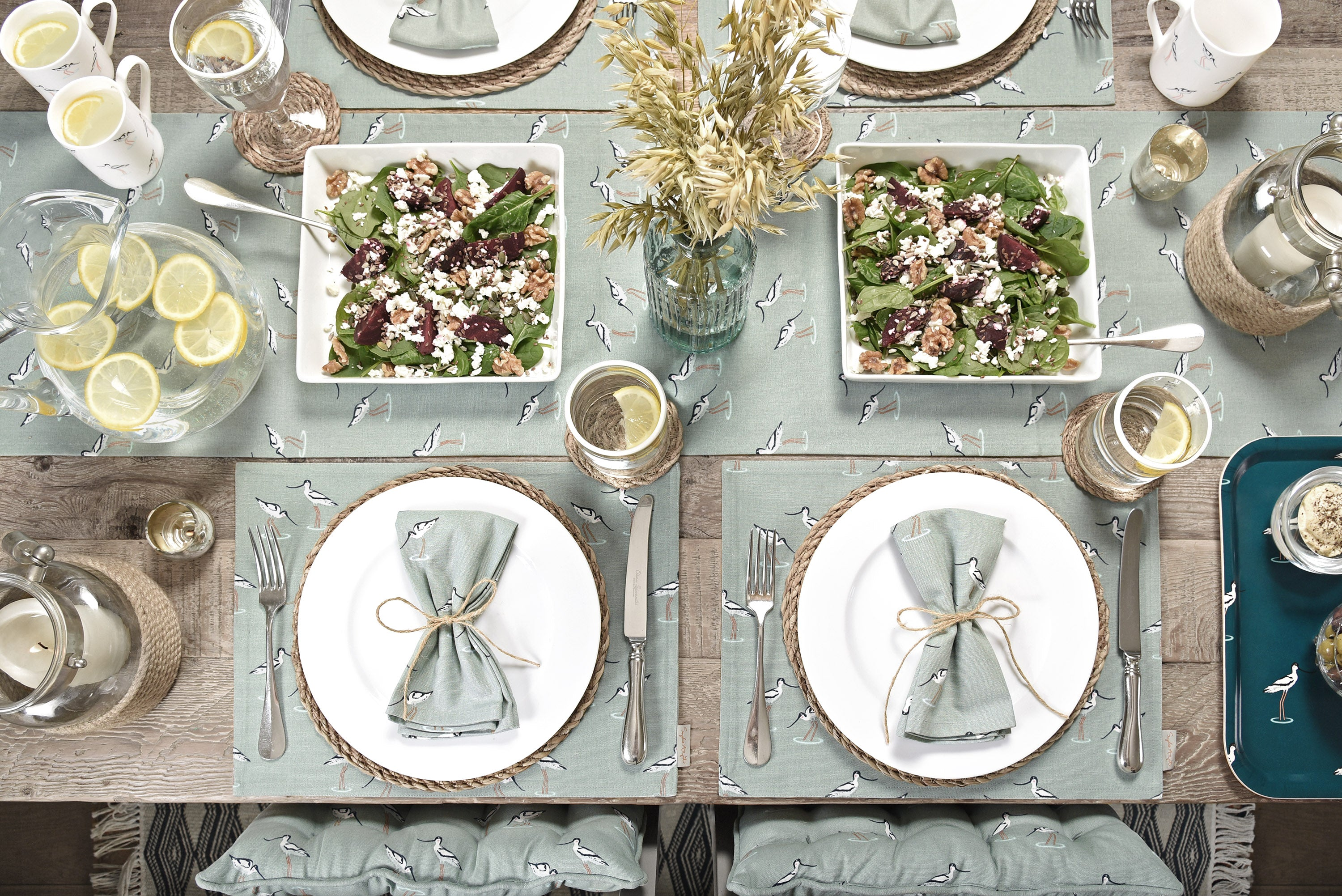 A beautiful table setting, with Sophie Allport's Coastal Birds design, with fabric place mats, napkins and table runner.