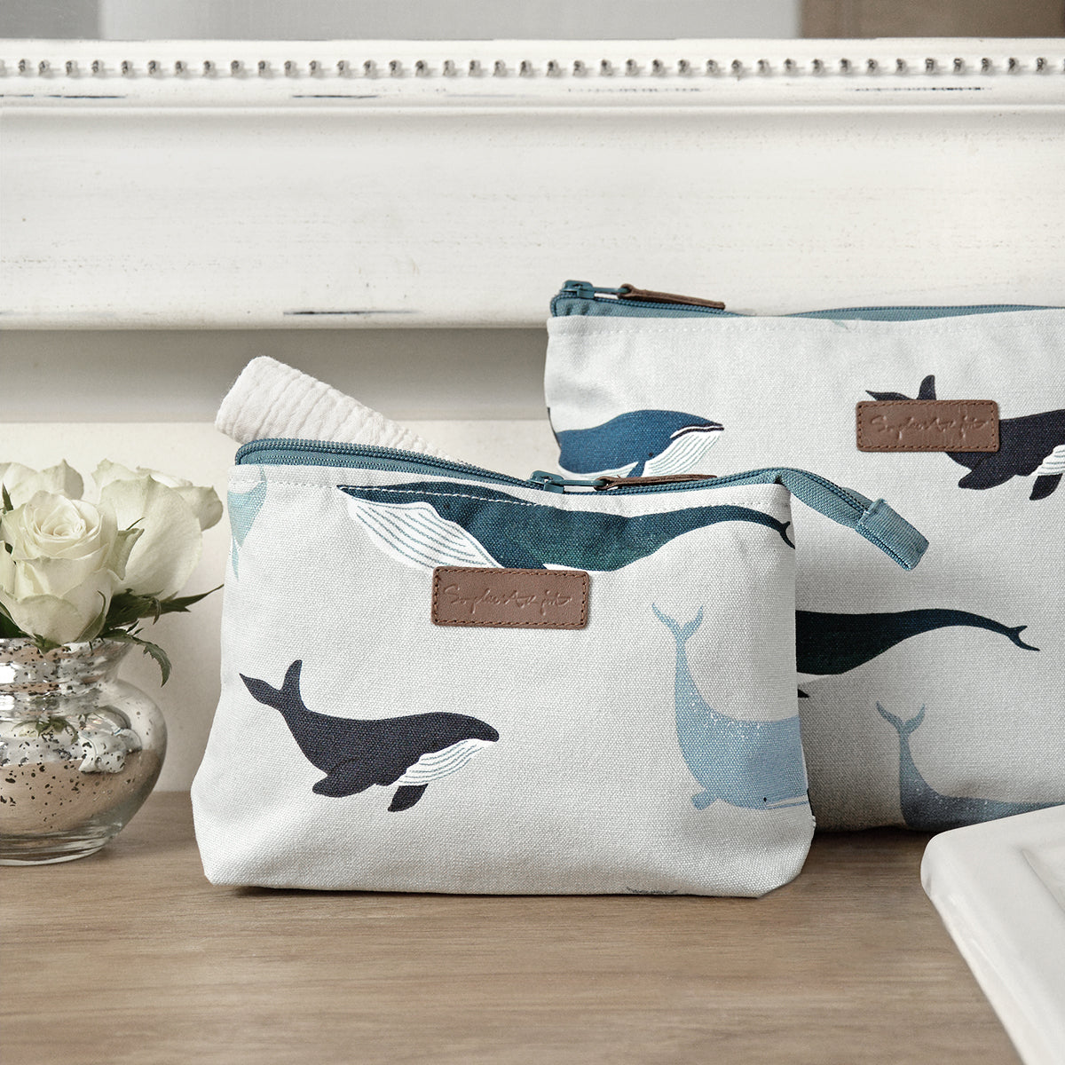 Whales make up and wash bag by Sophie Allport