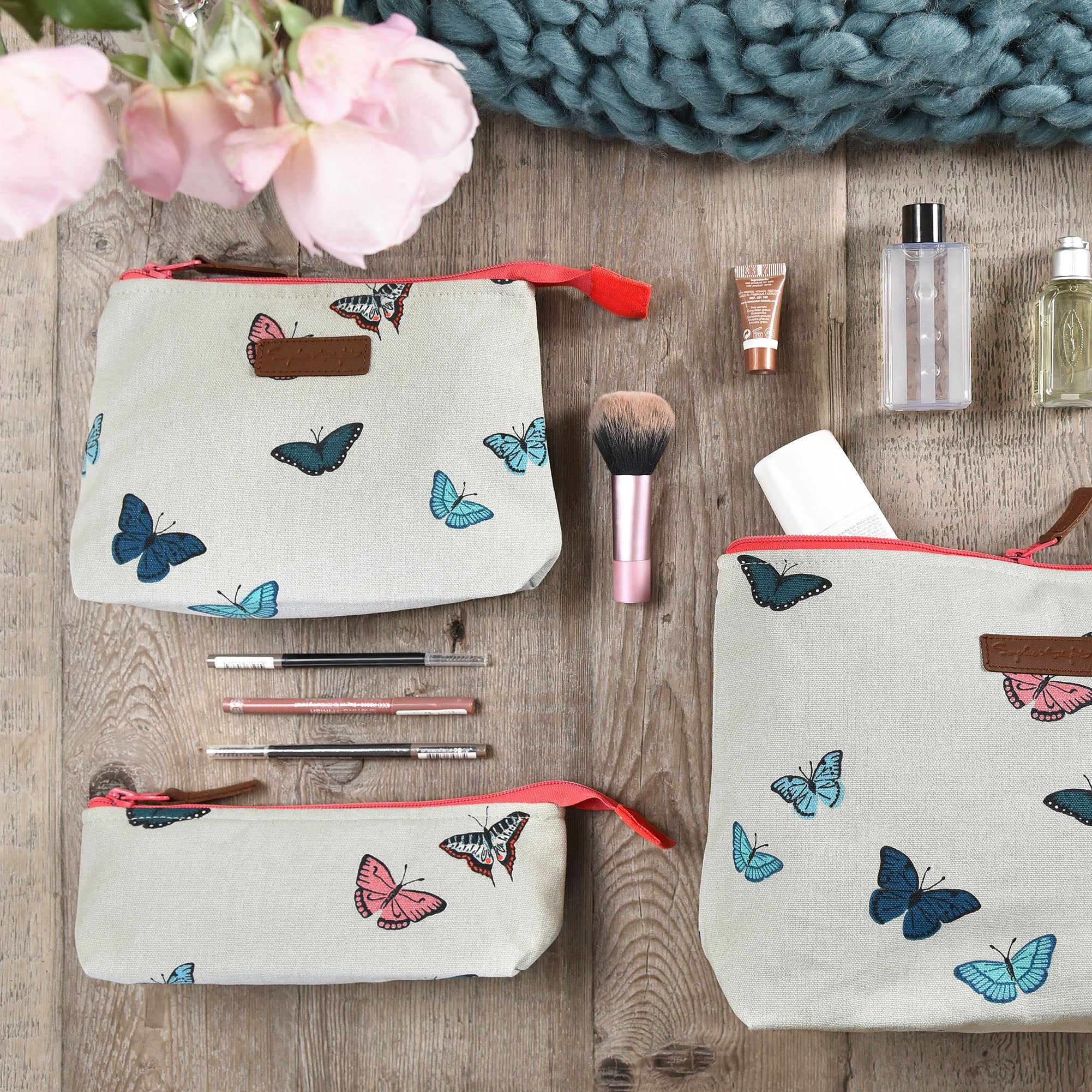 Makeup bag by Sophie Allport covered in colourful butterflies
