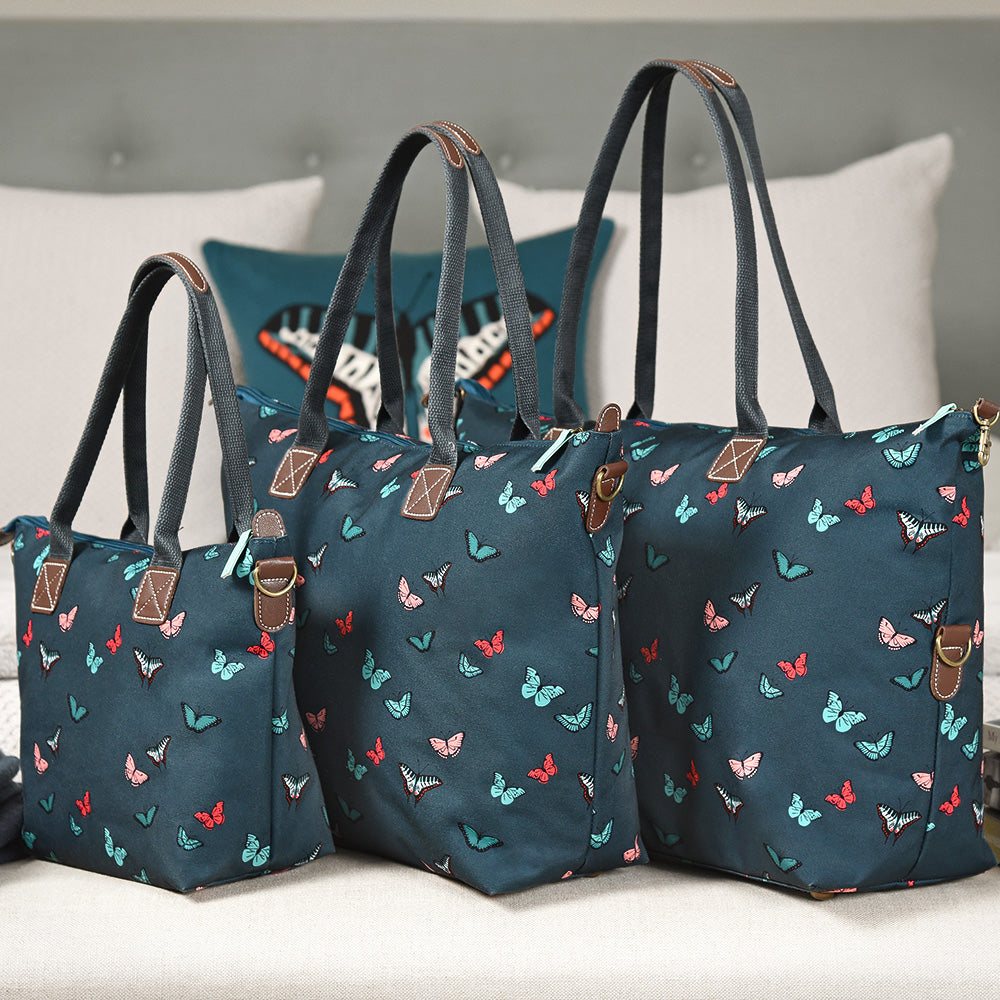 Blue Weekend Bag covered in colourful butterflies by Sophie Allport.