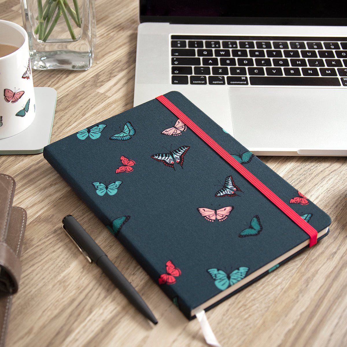 Navy notebook covered in butterflies by Sophie Allport