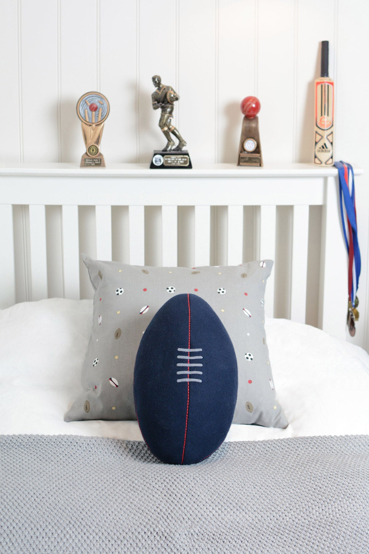 Knitted Rugby Ball Cushion