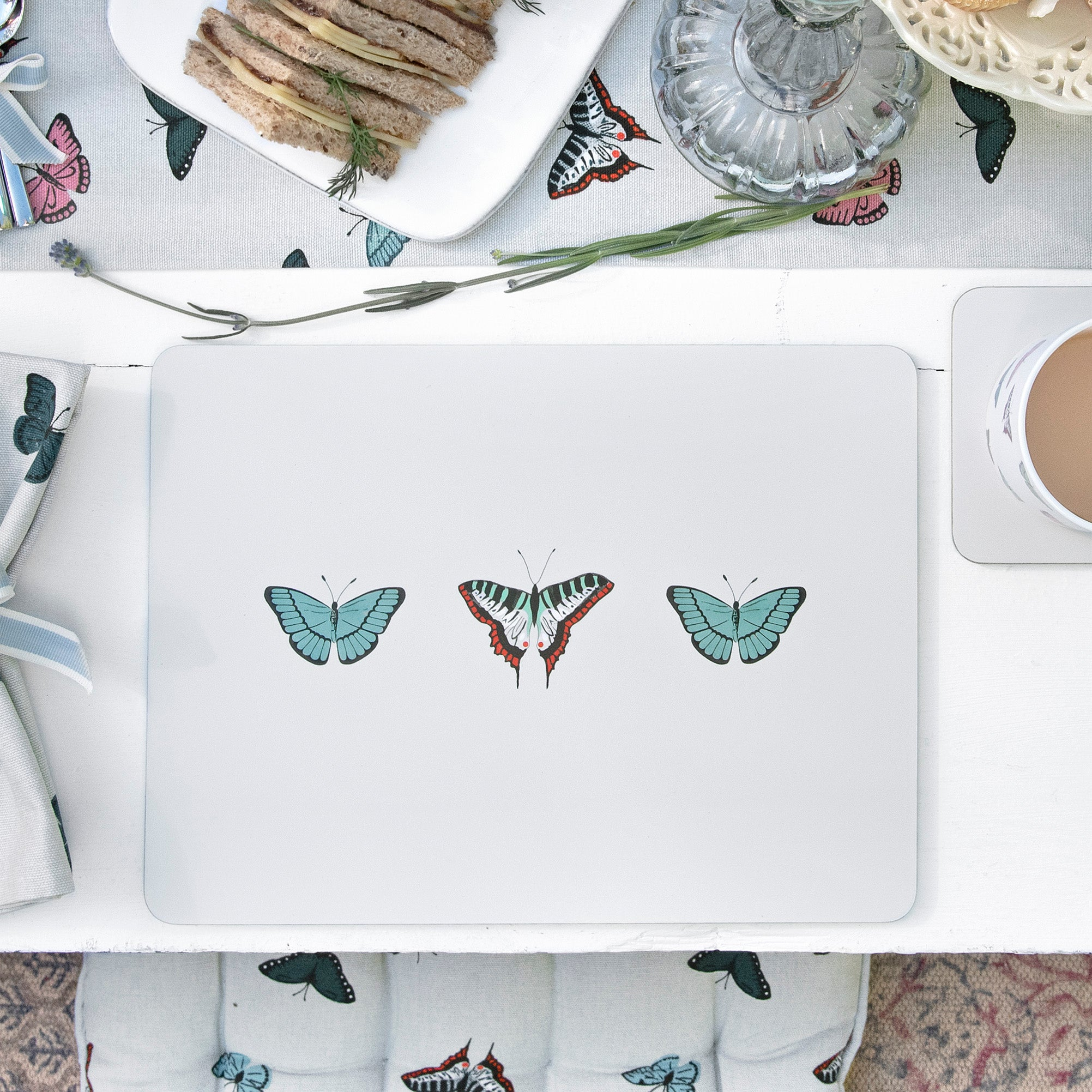A set of four Butterflies Grey Placemats by Sophie Allport.