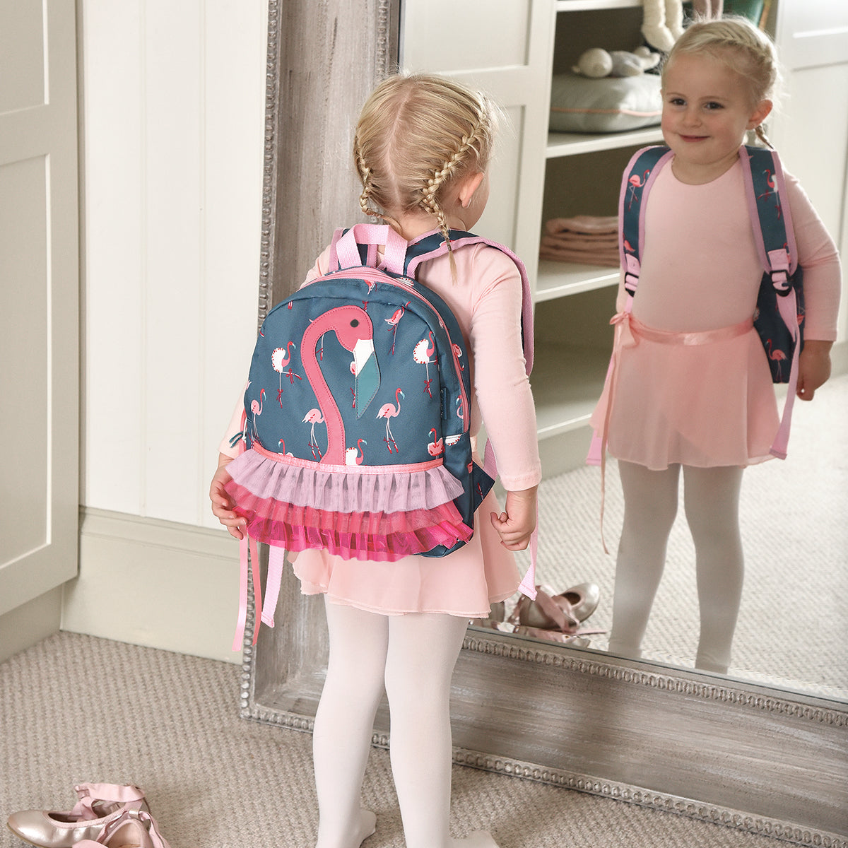Pink flamingo kids backpack with pom pom detailing by Sophie Allport