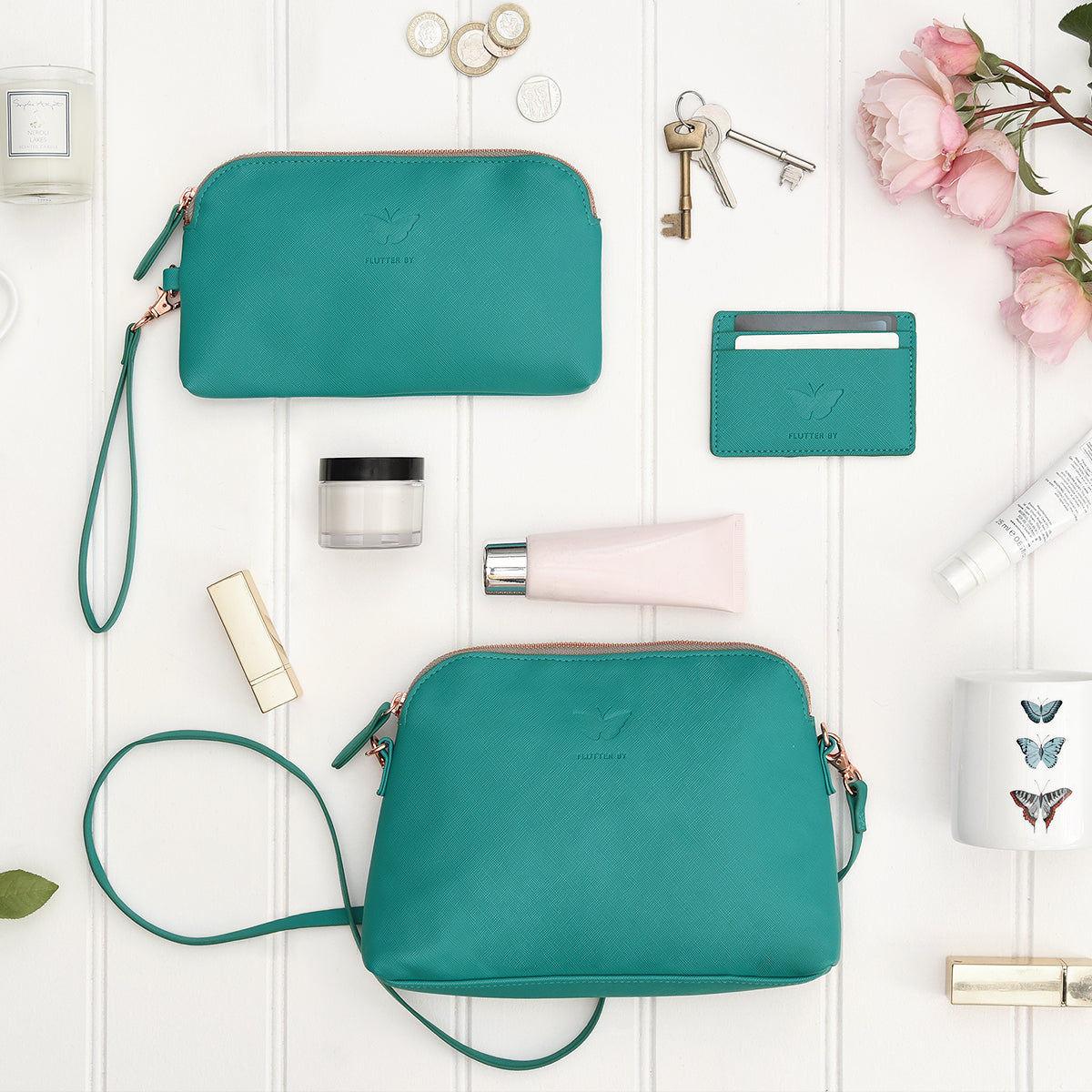 Teal butterflies oversized wallet by Sophie Allport.