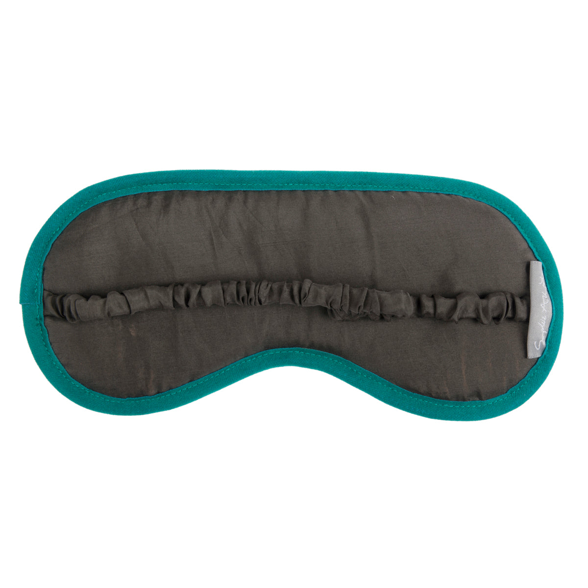 Silk sleep mask by Sophie Allport with velvet front and the words Flutter Bye on the front.