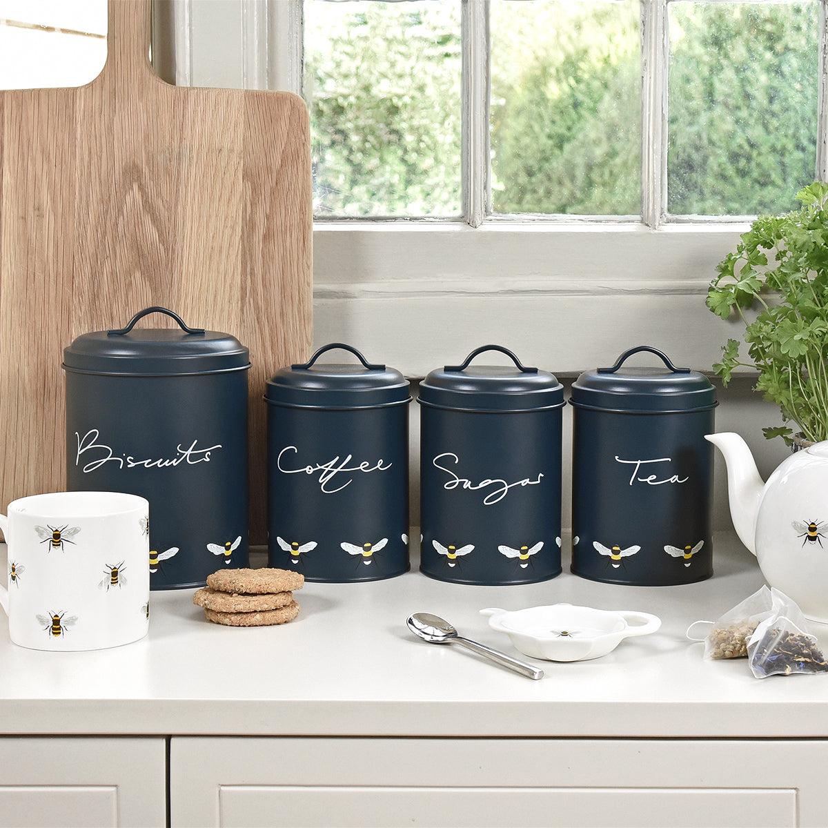 A set of three Sophie Allport storage tins for tea, coffee and sugar. Made from galvanised steel with a navy background.