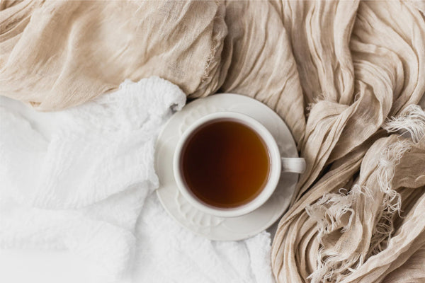 cup of tea with fabric gathered around it