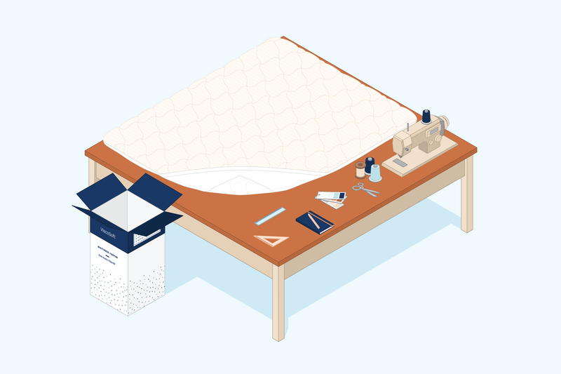 Illustration of anti-static mattress pad being constructed on the table of a seamstress