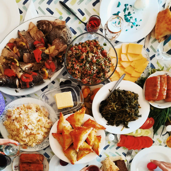 several different food dishes laid out on table
