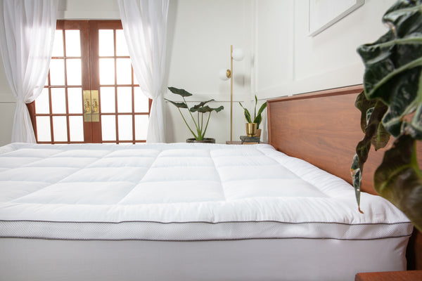 Side view of the Viscosoft Serene Hybrid Mattress Topper in a bedroom