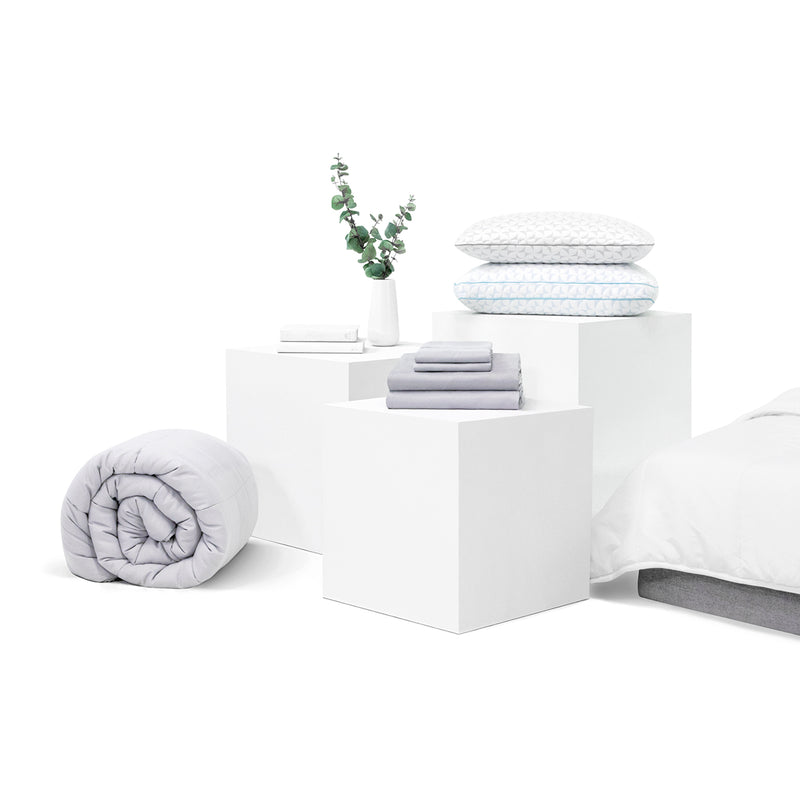 An assortment of viscosoft products arrange elegantly.  Products include sheets, pillows, mattress and comforters