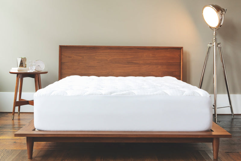anti-static mattress pad.  fiber filled for comfort.  An elastic skirt to keep the pad in place.