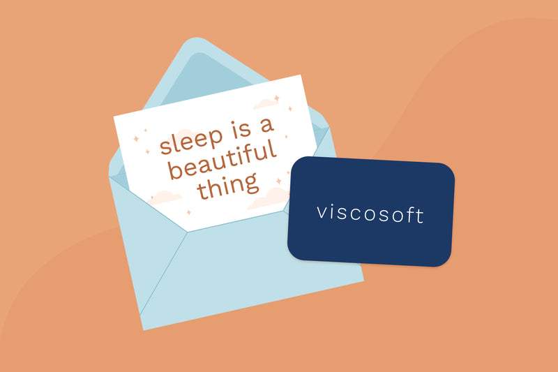 "Illustration of a ViscoSoft gift card on top of an envelope and a card that says ""Sleep is a beautiful thing"""
