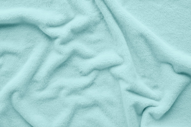 Close up of fleece material in aqua blanket