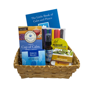 Gift basket with natural and wellness products for coping with loss and stress, including Cup of Calm tea, aromatherapy inhaler, stress relief bath salts, grief relief spray, rescue remedy pastilles, coloring mandala and markers.