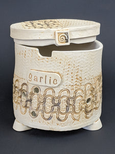 garlic keeper with label, brown pigment, swirl key on lid