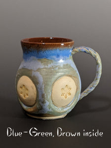 Pottery mug, snowflake design with handle