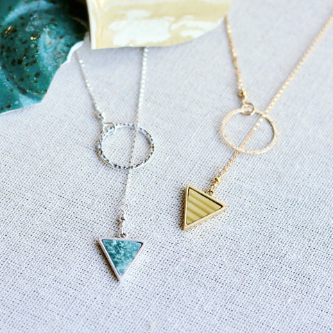 Lariat necklace with triangle pottery pendant. Gold and silver necklace options.