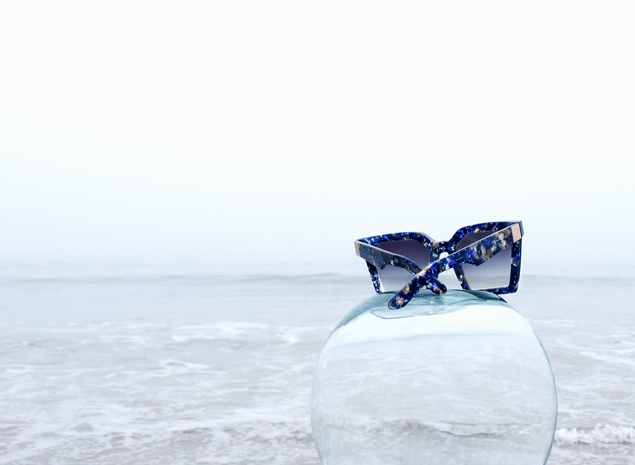 OVERSIZED BLUE SUNGLASSES, OCEAN, STILL LIFE PHOTOGRAPHY