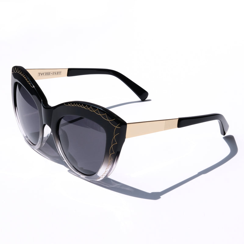 OVERSIZED BLACK CAT EYE SUNGLASSES, GOLD METAL DETAILS. GREY GRADIENT LENS. ART DECO DESIGN, LIMITED EDITION. DESIGNER EYEWEAR, LUXURY SUNGLASSES. CELEBRITY SUNGLASSES. FEMALE ENTREPRENEUR.