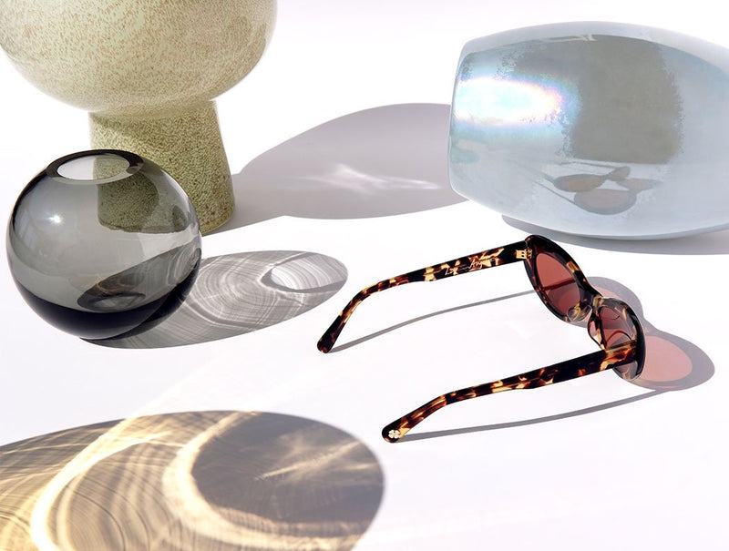 cat eye sunglasses, tortoise sunglasses, eyewear, designer, luxury, lifestyle, west elm, product photography, still life photography, vases, pottery