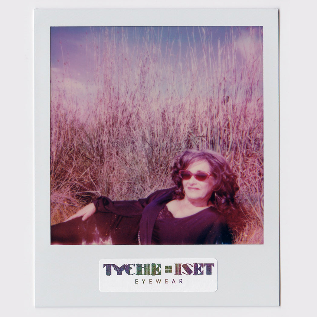 POLAROID PHOTO, WOMAN IN GRASS WEARING OCEANA IN HONEY SUNSET, PINK CAT EYE SUNGLASSES