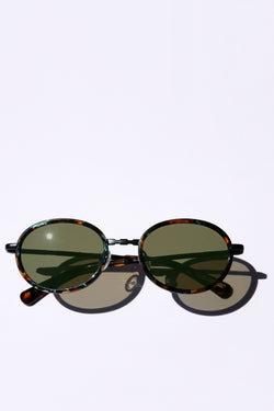 MATTE BLACK CLASSIC UNISEX OVAL SUNGLASSES, MATTE BLACK METAL DETAILS. OLIVE GREEN LENS. ART DECO DESIGN, LIMITED EDITION. DESIGNER EYEWEAR, LUXURY SUNGLASSES. CELEBRITY SUNGLASSES. FEMALE ENTREPRENEUR.
