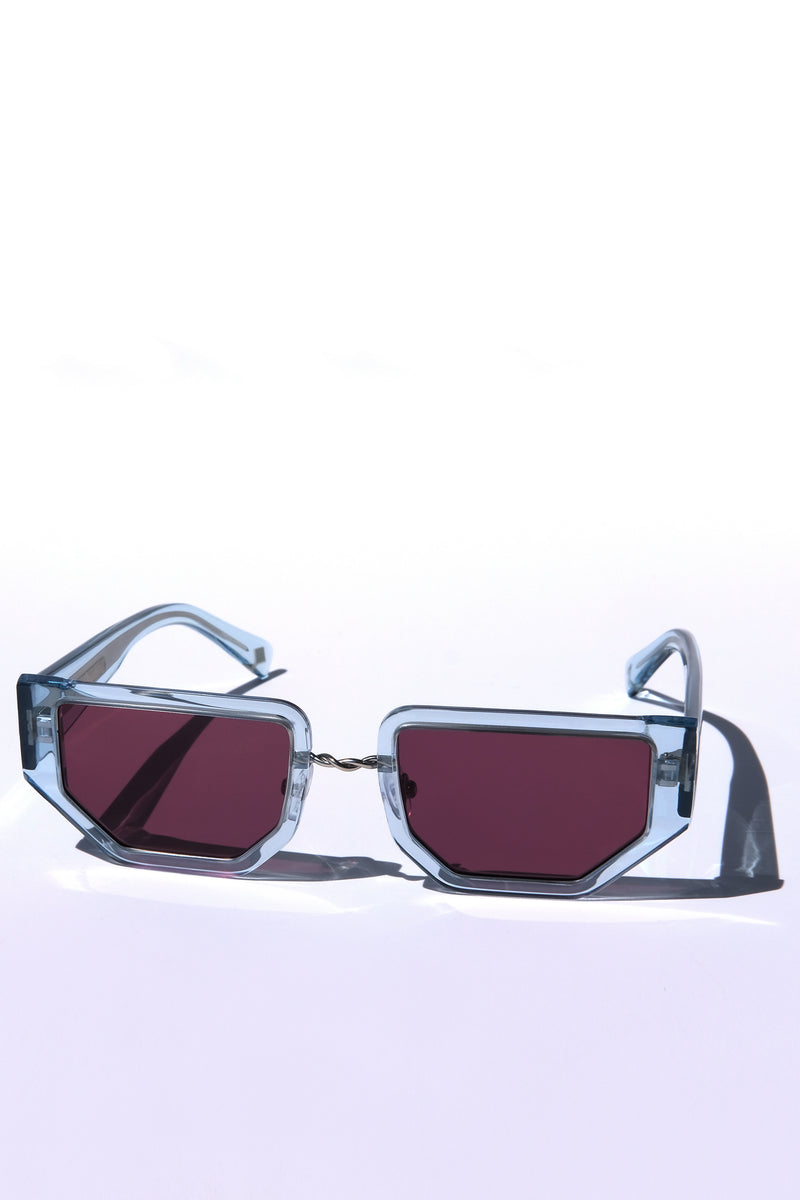 LIGHT BLUE CRYSTAL FUTURISTIC MODERN UNISEX SUNGLASSES, SILVER METAL DETAILS. DEEP MAROON PURPLE LENS. ART DECO DESIGN, LIMITED EDITION. DESIGNER EYEWEAR, LUXURY SUNGLASSES. CELEBRITY SUNGLASSES. FEMALE ENTREPRENEUR.