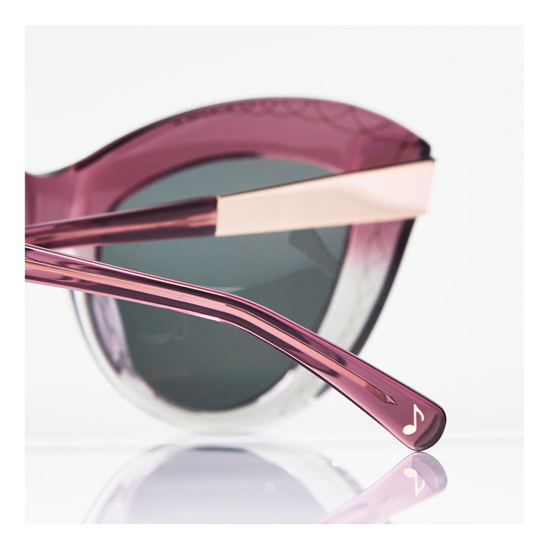 MUSIC NOTE TEMPLE CHARM DETAIL. OVERSIZED MAGENTA PINK CAT EYE SUNGLASSES, GOLD METAL DETAILS. GREY LENS. ART DECO DESIGN, LIMITED EDITION. DESIGNER EYEWEAR, LUXURY SUNGLASSES. CELEBRITY SUNGLASSES. FEMALE ENTREPRENEUR.