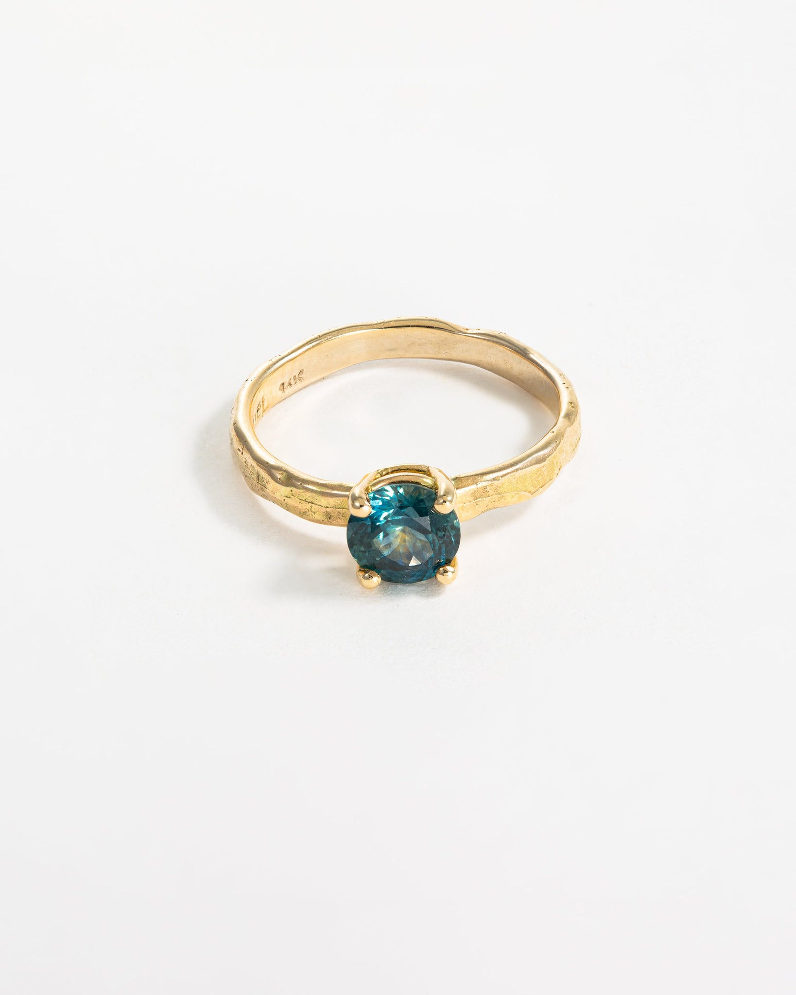 Forge Solitaire in Yellow Gold with Blue Montana Sapphire