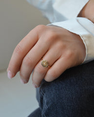 Helios ring in 14K gold with a fine band and a diamond