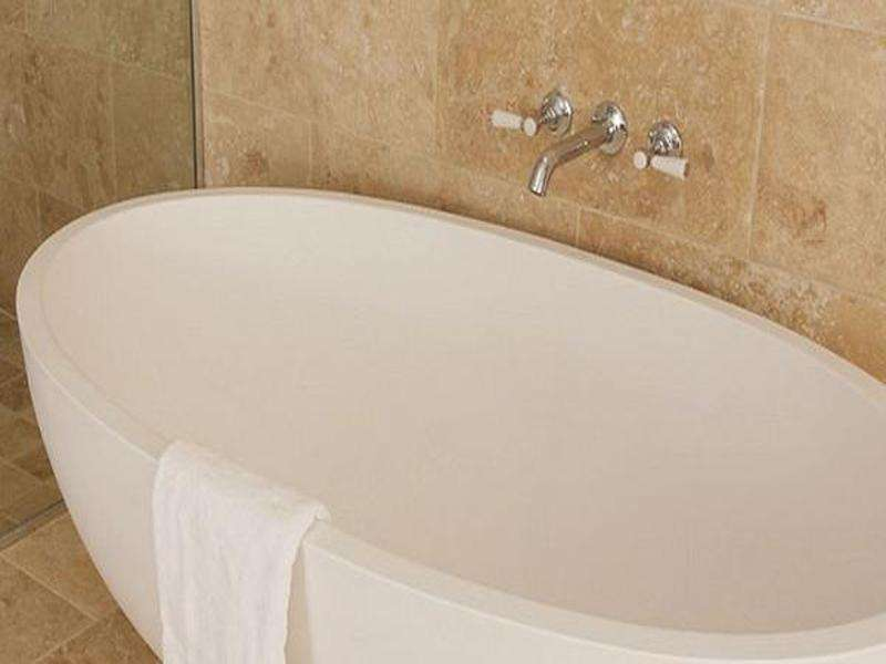 Tyrrell and Laing Petit Stone Freestanding Soaker Tub - towelwarmers