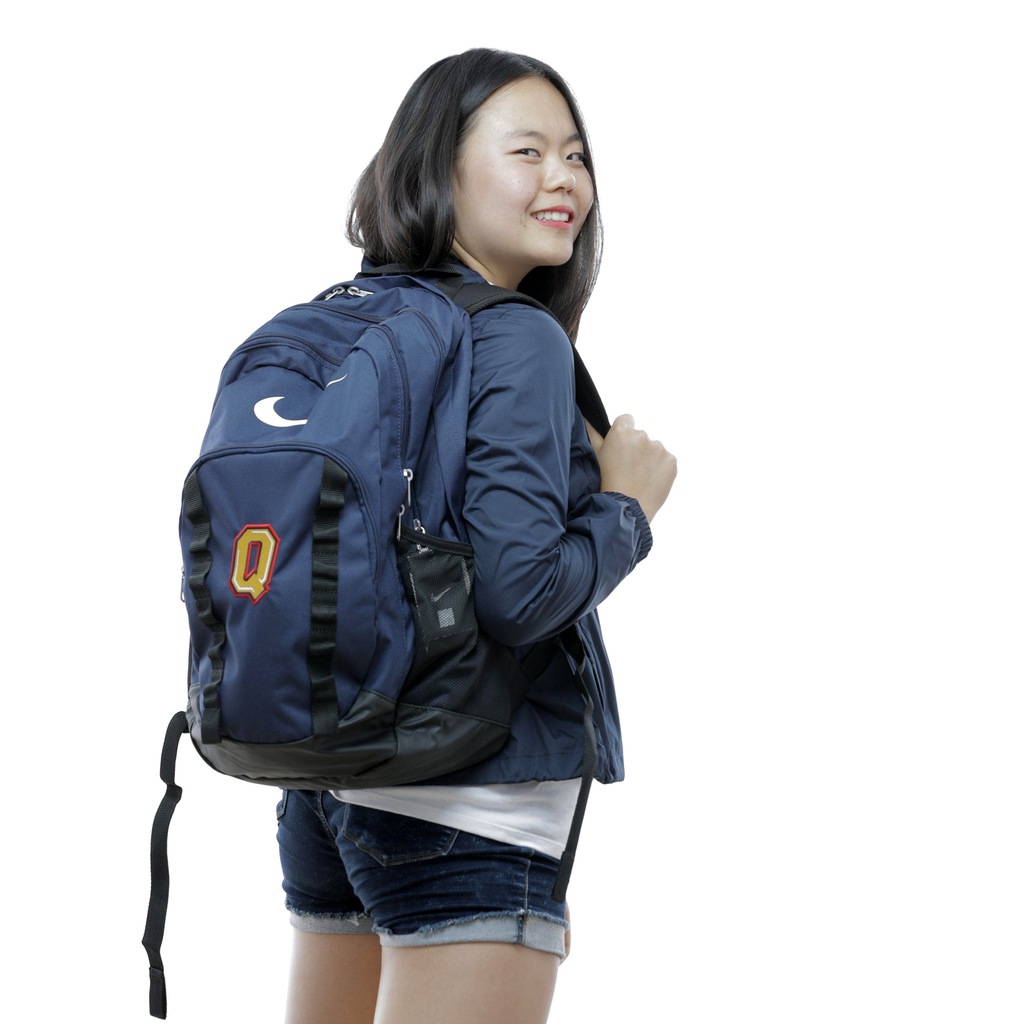 Blue Nike Backpack with Queen's Insignia Female Model