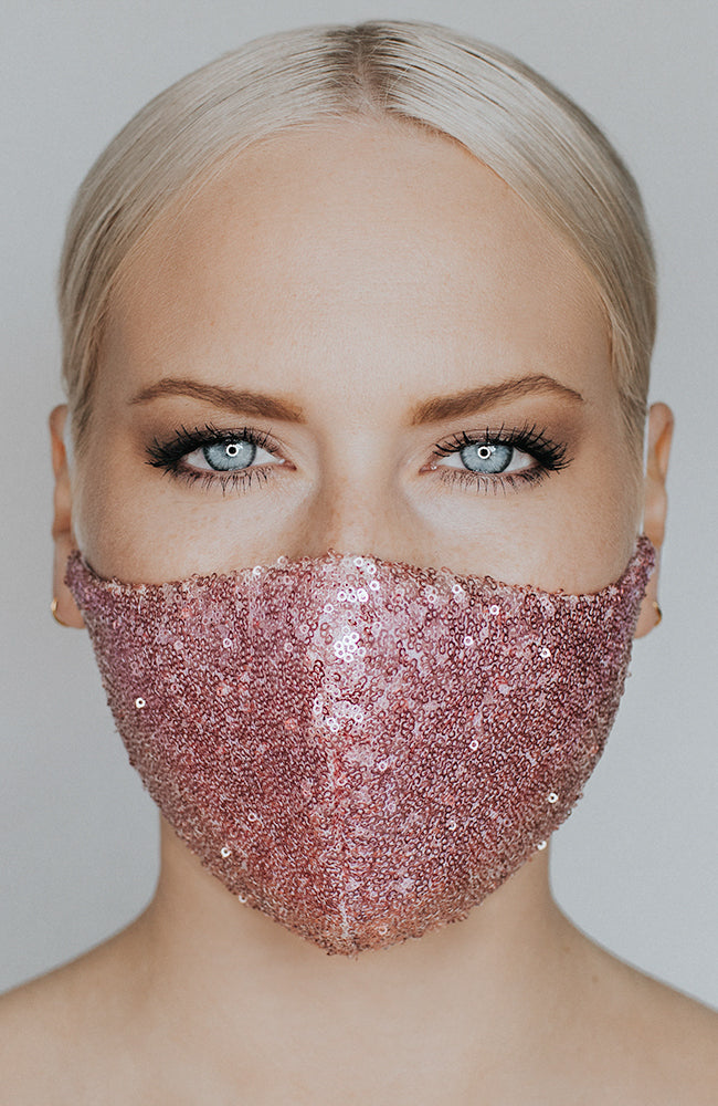 Model is wearing Disco Ball Mask in Sparkling Rose by Katie May