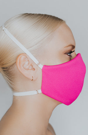 Model wearing Protected AF mask in Electric Pink by Katie May