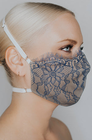 Model is wearing Provocateur mask in Steel Blue/Nude by Katie May