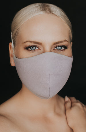 Model wearing Protected AF mask in Dove by Katie May